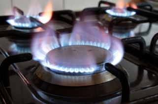 Three gas ring burners on a home cooker.
